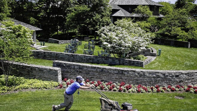 A groundskeeper mows near the clubhouse during a practice round of the 2019 Memorial Tournament at Muirfield Village Golf Club in Dublin. The course will be the site of the PGA Tour's Workday event July 9-12 and the Memorial on July 16-19.