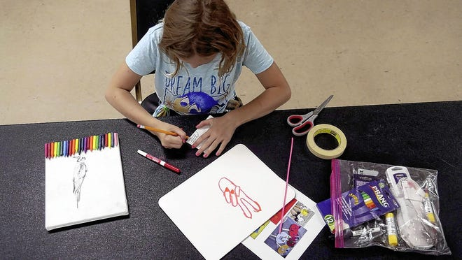Ella Kinsinger, 11, of Grandview Heights works on several art projects June 18 during a city parks and recreation program at the Grandview Center. The center now is reopening for regular fitness classes and other activities, with limited numbers of participants.