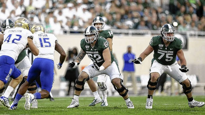 Offensive lineman Luke Campbell (62), a 2016 Olentangy graduate, is one of four players from the Olentangy school district who are expected to be among the contributors this season for the Michigan State football team under first-year coach Mel Tucker.
