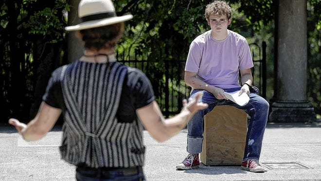 Philip Hickman, Actors' Theatre of Columbus artistic director, coaches Bobby Sisson, 17, of Columbus during the theater company's Globe School Acting Shakespeare camp July 15 in the Schiller Park amphitheater in Columbus. Actors' Theatre has a number of additional camps coming up.