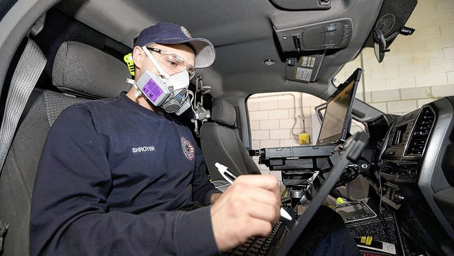 Jackson Township firefighter/paramedic Mitch Shroyer demonstrates new methods used in making a report after each medic run April 15 at the firehouse of Station 202, 3650 Hoover Road. Township trustees are considering whether or not to put a levy that would help fund the Jackson Township Fire Department on the November ballot.