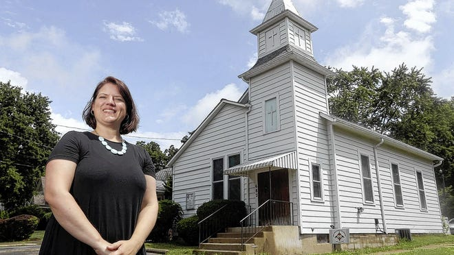 "Kate LaLonde, director of the Worthington Historical Society, created the society's ""African American History in Worthington"" self-guided virtual tour. She is pictured Aug. 4 outside the former St. John AME Church building, which was constructed in 1914 at 682 Plymouth St. in Worthington and is one of the stops along the tour."