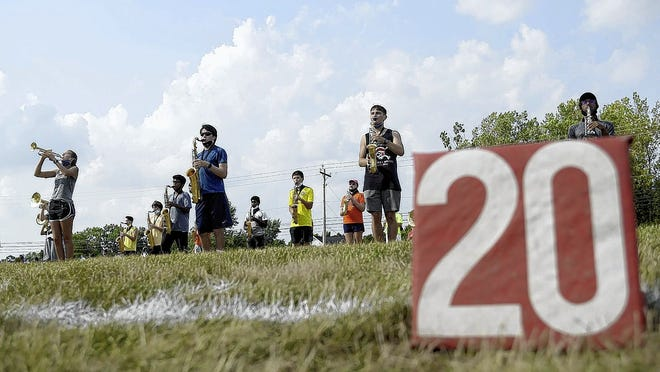 Members of the Olentangy Orange High School marching band practice in formation Aug. 26 at the school.