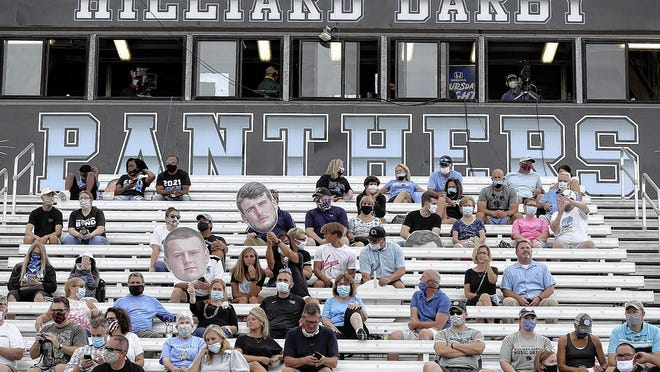 Hilliard Darby High School families were spaced out in the bleachers per COVID-19 coronavirus social-distancing protocols as they wait for the start of the opening game of the season against Hilliard Davidson on Aug. 27. Davidson won 17-13.