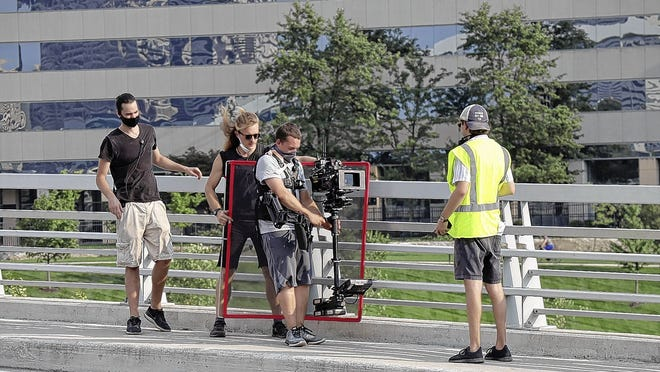 """Members of the crew shooting the """"They/Them/Us"""" movie check a shot. Most of the scenes in the romantic comedy were filmed in German Village, the Brewery District, Victorian Village and downtown Columbus locations."""