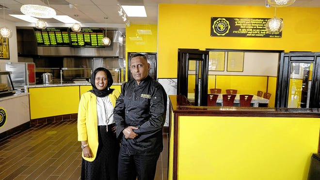 "The husband-and-wife team of Abdirahman ""Abcos"" Ahmed (right) and Sagal Aden opened Afra Grill on June 1 at 1635 Morse Road in north Columbus."