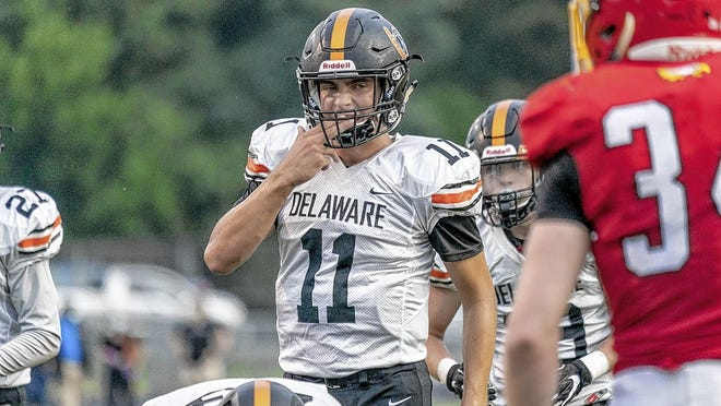Delaware Hayes junior quarterback Austin Dowell surveys the defense during a 14-6 loss to host Big Walnut in the opener Aug. 28. Dowell has been making steady progress in his first season as a starter for the Pacers, who were 0-3 before playing Westerville South on Sept. 18.
