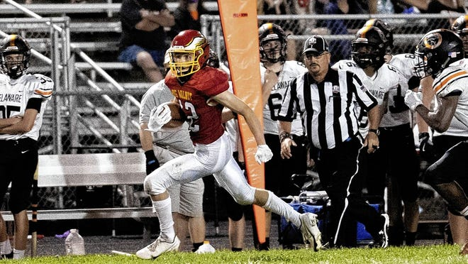 Zeus Martinez of Big Walnut races down field after catching a pass during a 14-6 victory over visiting Delaware on Aug. 28. The Golden Eagles, who were 2-1 entering their game against Worthington Kilbourne on Sept. 18, will play at Westerville North on Friday, Sept. 25.