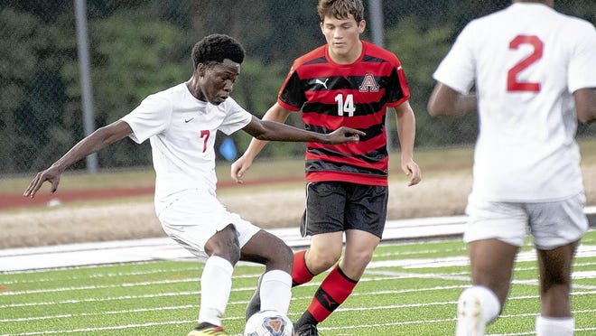 Derrick Ibrahim (7), a senior forward who scored 15 goals last season, returns to lead the Centennial boys soccer team under coach Scott George.
