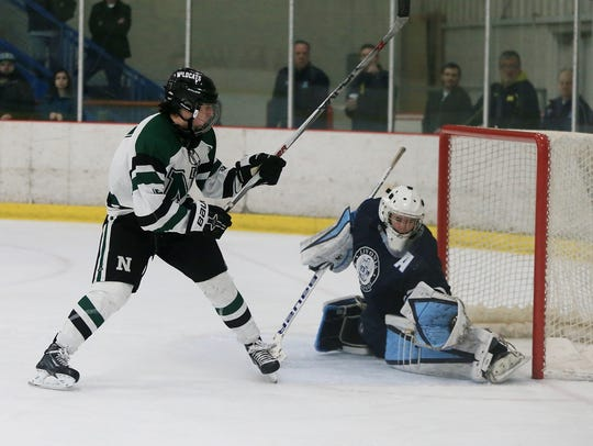 Stevenson goalie Will Tragge (right) makes the glove