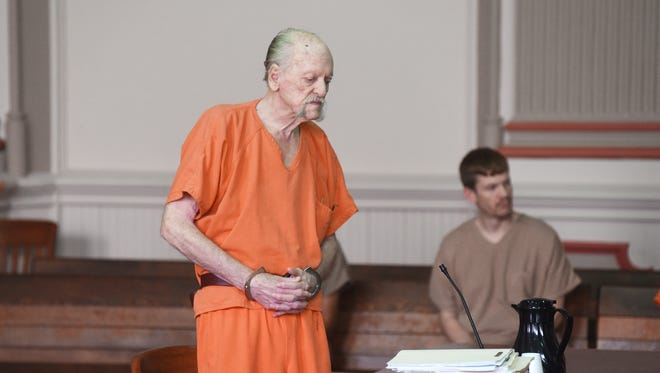 Larry McKee waits for his lawyer to return from a trip to the bench in Muskingum County Common Pleas Court on Monday. McKee was sentenced to 10 years for sexually assaulting an 8-year-old.
