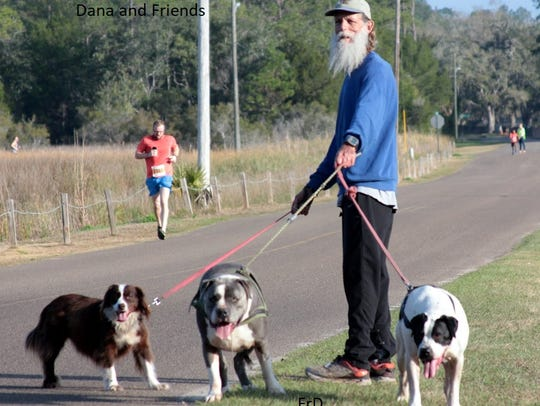 Dana Stetson and friends watch the Flash 12K and 6K runners.