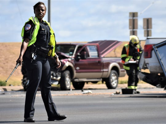 An officer directs traffic with a baton following a wreck on June 25, 2018 on Sherwood Way.