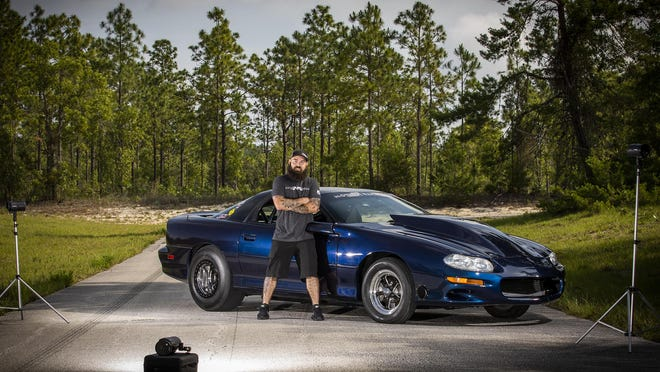 Jared Gifford and his 2001 high-performance Z28 Camaro.