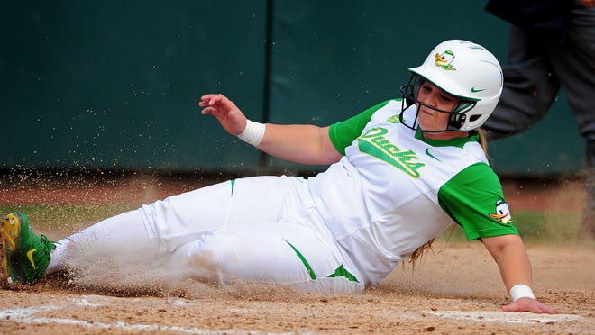 Oregon base runner Hailey Decker, from McNary, slides home to score a run against Louisiana-Lafayette at Howe Field on Saturday in Eugene.