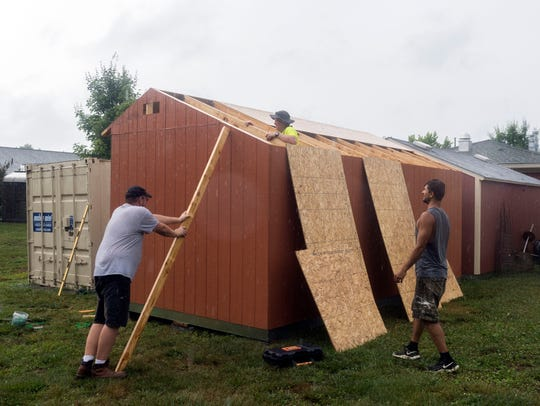Workers construct Tuff Shed on the grounds Ben Atchley