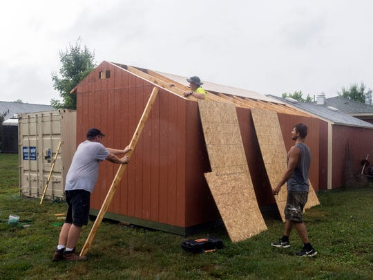 Workers construct Tuff Shed on the grounds Ben Atchley Tennessee State Veterans' Home on Thursday, June 21, 2018. The shed was purchased with part of a $15,000 grant from the Home Depot Foundation.