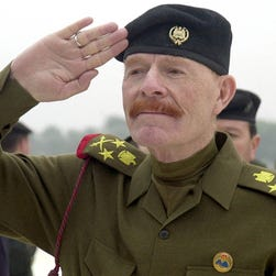In this Sunday, Dec. 1, 2002 file photo, Iraqi Vice chairman of the Revolutionary Command Council, Izzat Ibrahim al-Douri salutes during a ceremony at the Martyrs Monument in Baghdad.