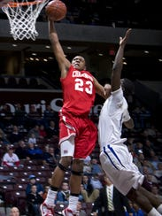 Chaminade College Prep guard Bradley Beal, left, dunks