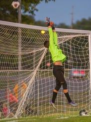 Raiders goalkeeper Calvin Walters (00) directs a shot