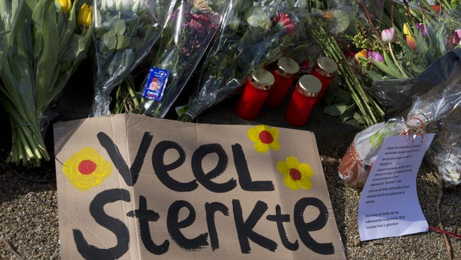 "A sign reading ""Lots of Strength"" and flowers are put at a makeshift memorial for victims of a shooting incident in a tram in Utrecht, Netherlands, Tuesday, March 19, 2019."