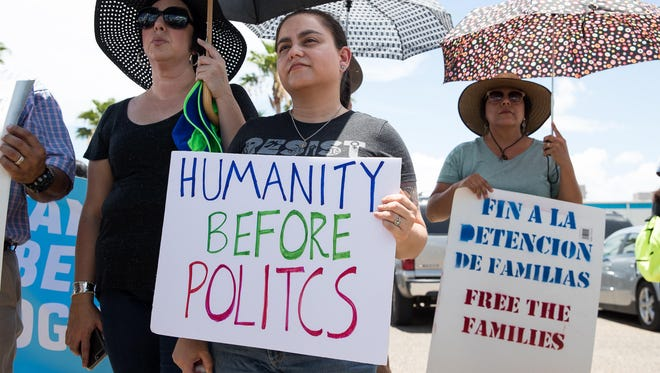 People gather for a vigil lead by the Families Belong Together campaign on June 17, 2018, outside U.S. Border Patrol McAllen Station, calling for the end of family separation.