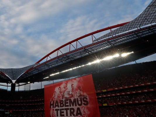 A banner hangs from the roof of the stadium at the end of the Portuguese league soccer match between Benfica and Vitoria de Guimaraes at the Luz stadium in Lisbon, Saturday, May 13, 2017. Benfica won the match 5-0 to clinch the championship title for the fourth season in a row. (AP Photo/Pedro Rocha)
