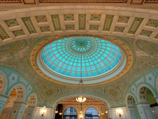 The Chicago Cultural Center, a former city library, showcases the world's largest Tiffany art-glass dome, which is 38 feet in diameter and contains 30,000 pieces of glass.