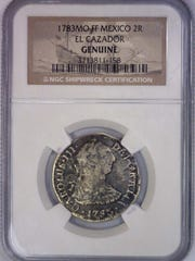 "A coin from the El Cazador, known as the ""shipwreck that changed the world""."