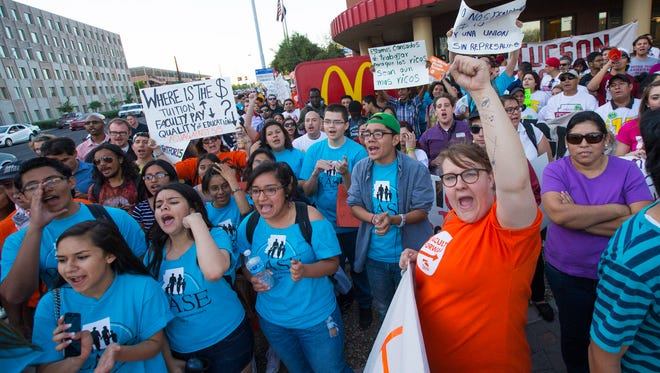 Hundreds of protesters rally outside McDonalds on Rural near ASU in Tempe to raise the minimum wage to $15 April 15, 2015.