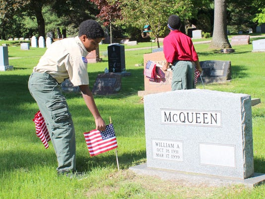 2015 Memorial Day Toure Black placing flags in Franklin cemetary.jpg