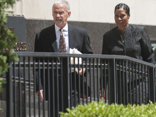 Monica Morgan-Holifield and her attorney Steve Fishman