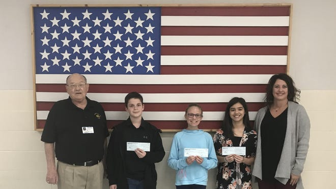 "Pinkston Middle School's sixth-grade winners of the 2017-18 Elks Americanism Essay Contest recently were honored at an awards assembly. Over 280 essays were entered with the theme ""Why Our Veterans Are America's Heroes."" The top three winners received a check for $100 each from the Mountain Home Elks Lodge and their essays will be forwarded for state and national judging. Pictured are: (from left) Stu Friend, Elks president; Gray Padgett, Merritt McConnell, Gabrielle Brevard, essay winners; and Vonya Schaufler, sixth grade social studies teacher and Elks Americanism Chair."
