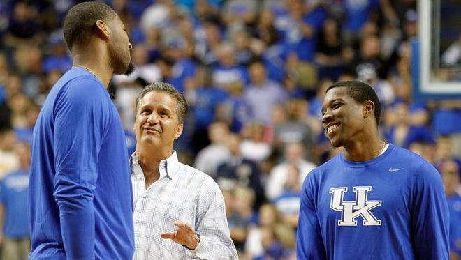 From left, Demarcus Cousins, John Calipari and Eric Bledsoe share a laugh before the UK Alumni game at Rupp Arena on Sept. 9, 2013.