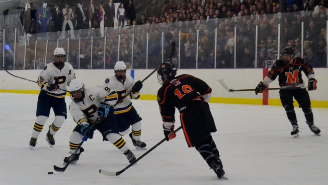Pelham forward Ben Hurd gets a shot on goal in the second period of the Pelicans' 4-2 win over Mamaroneck on Monday.