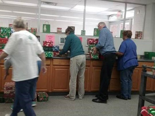 Volunteers work on shoe boxes for Operation Christmas Child at Ontario Free Methodist Church.