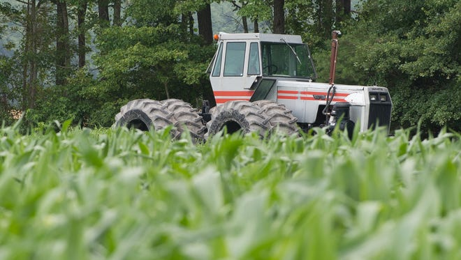 A tractor sits next to a field of sweet corn owned by Baxter Farms Inc. in Georgetown on Friday. Corn is the top crop in Delaware, taking up more than 178,000 acres.