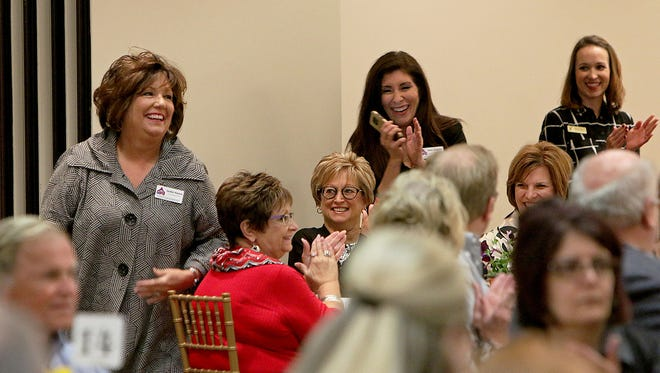 Jackie Hamm (left) and other representatives of THE Kitchen celebrate after being named the Non-Profit Category Better Business Bureau Torch Award at Tuesday's awards banquet at the Wichita Falls Country Club.