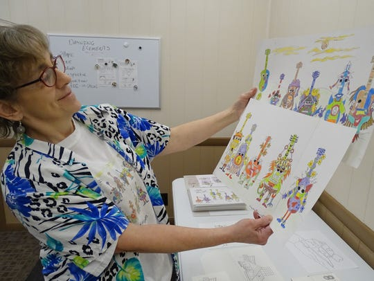 Lou Anne Michel looks over the characters she uses