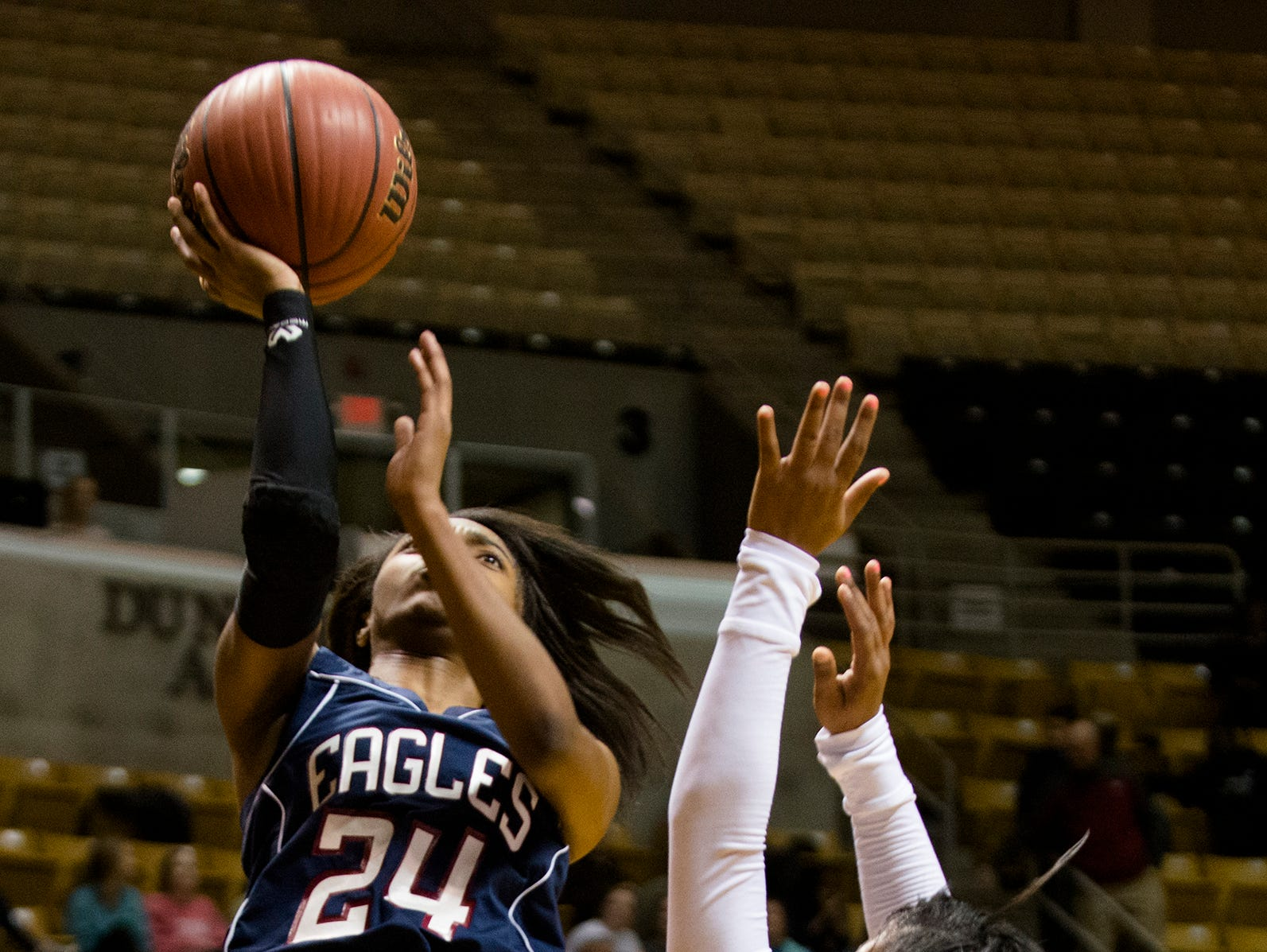 Montgomery Academy's Jade Brooks (24) shoots over Midfield's Kierra Hicks (5) during the AHSAA Class 3A Central Regional Championship on Thursday, Feb. 19, 2015, at the Dunn-Oliver Acadome in Montgomery, Ala.