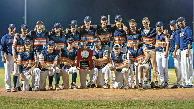 The Fort Smith Sportsman American Legion baseball team gathers around the Senior AAA State Tournament Champions trophy on Tuesday, July 28, 2020 after defeating Russellville 4-2 for the title in Sheridan.