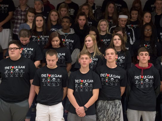 Members of the West York High School student body observe