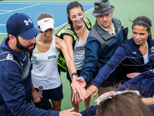 Queens University head tennis coach Billy Boykin, left, and his father, Jim Boykin, huddle with the team before a match against Anderson University on Saturday, March 25, 2017 in Anderson.
