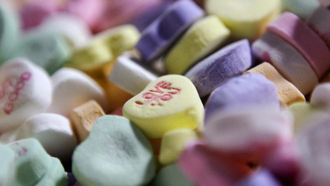 """Sweethearts"" candy is held in bulk prior to packaging at the New England Confectionery Company in Revere, Mass. The candies won't be on store shelves this Valentine's Day."