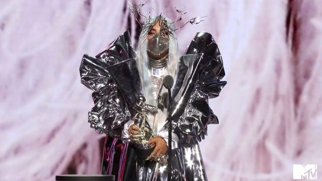 Lady Gaga appears, in a video grab, wearing one of her extravagant masks during Sunday's MTV Video Music Awards.