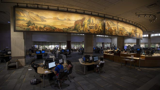 """Three panels of """"The History of Ranching"""" mural by Buck Winn are on display at the Alkek Library at Texas State University in San Marcos."""