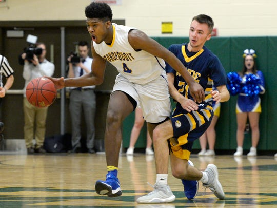 Irondequoit's Gerald Drumgoole, left, dribbles by Wayne's Tom Bolt during the Class A regional qualifier played at Rush-Henrietta High School, Wednesday, March. 7, 2018.