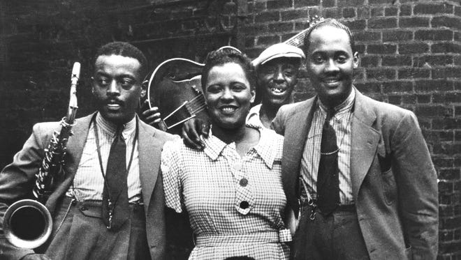 Legendary singer Billie Holiday with musicians including Ben Webster, left, and Johnny Russell, right, in Harlem in 1935.