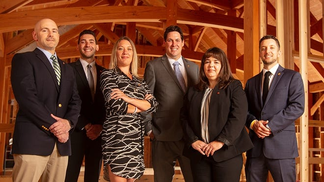 Meet some of the staff at the new LNB branch in Farmington: Michael Fratto (left), commercial loan officer; Angelo Battoglia, assistant branch manager; Heidi King, mortgage originator; Charles Parkhurst, branch manager; Connie Shedrick, customer service representative; and David DeRaddo, financial services representative.