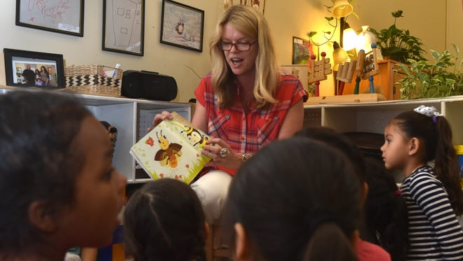 Mary Maranville, founder of Students for Eco-Education and Agriculture, reads a book to preschoolers Friday at the South Oxnard Childhood Development Center as part of the Take 5 and Read to Kids campaign by First 5 Ventura County, which provides preschool and other programs for young children and their families..